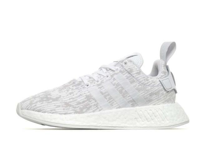 0c8c148a8 The Iconic 3-stripes The Sides on Invaber - Adidas Originals Nmd R2 ...